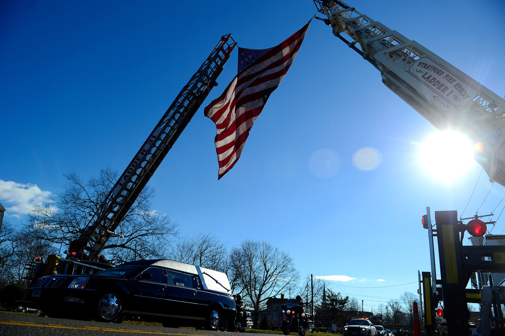 Description of . Stratford firefighters stand at attention during the funeral service for Victoria Soto, 27, in Stratford, Connecticut on Wednesday, December 19, 2012. Soto, a first grade teacher, was shot and killed during the Newton shooting as she attempted to protect her students against the gunman. AAron Ontiveroz, The Denver Post