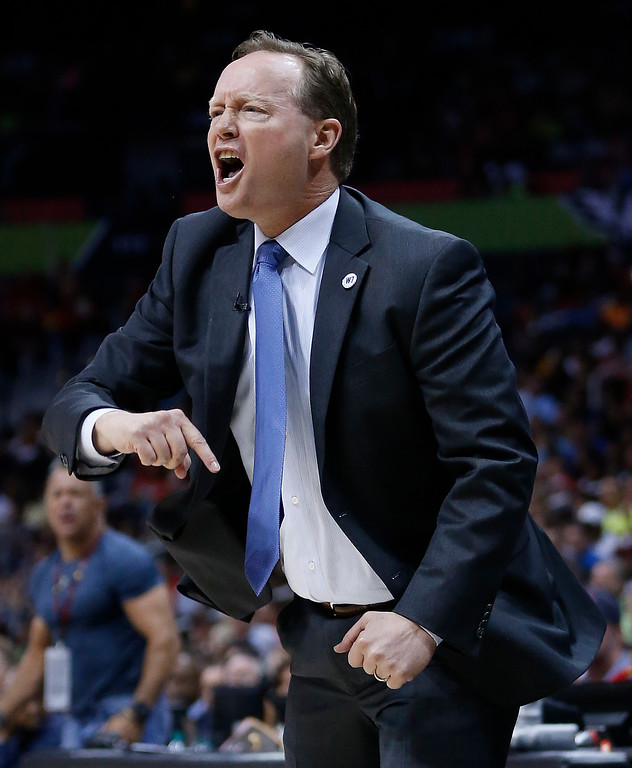 . Atlanta Hawks head coach Mike Budenholzer speaks to his players in the first half of Game 4 of the second-round NBA basketball playoff series against the Cleveland Cavaliers, Sunday, May 8, 2016, in Atlanta. (AP Photo/John Bazemore)