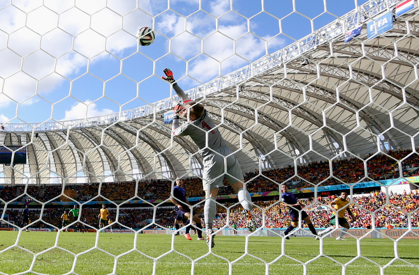 . Australia\'s Tim Cahill, right, scores his side\'s first goal past Netherlands\' goalkeeper Jasper Cillessen during the group B World Cup soccer match between Australia and the Netherlands at the Estadio Beira-Rio in Porto Alegre, Brazil, Wednesday, June 18, 2014. (AP Photo/Martin Meissner)