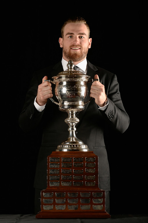 . Ryan O\'Reilly of the Colorado Avalanche poses for a portrait with the Lady Byng Memorial Trophy during the 2014 NHL Awards at Encore Las Vegas on June 24, 2014 in Las Vegas, Nevada.  (Photo by Harry How/Getty Images)