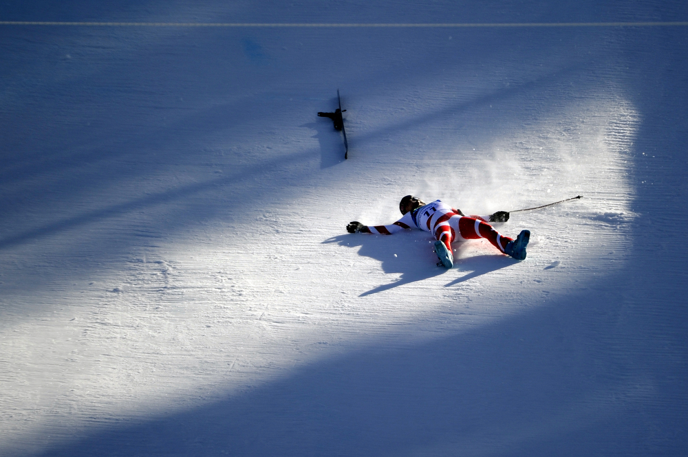 . Swiss Dominique Gisin lies on the course after a crash the during  the Women\'s Vancouver 2010 Winter Olympics Downhill event at Whistler Creek side Alpine skiing venue on February 17, 2010. (OLIVIER MORIN/AFP/Getty Images)