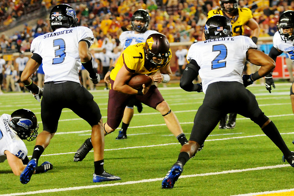 . Minnesota quarterback Mitch Leidner puts his head down as he drives toward s the end zone on a 5-yard touchdown run against Eastern Illinois in the fourth quarter. (Pioneer Press: John Autey)