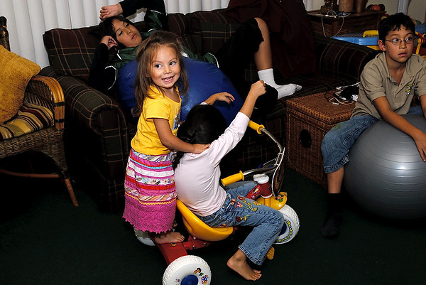9/14/07 Madeline and Sophie riding the tricycle