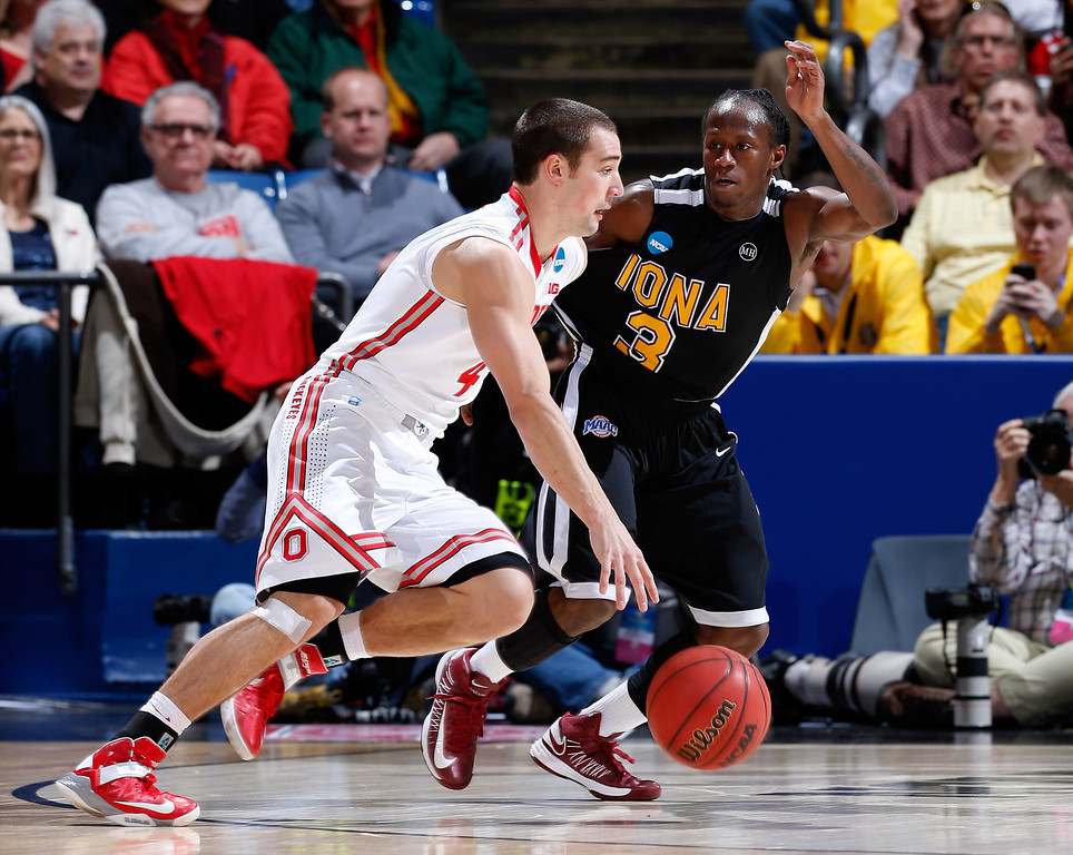 . DAYTON, OH - MARCH 22: Aaron Craft #4 of the Ohio State Buckeyes drives with the ball against Tavon Sledge #3 of the Iona Gaels in the first half during the second round of the 2013 NCAA Men\'s Basketball Tournament at UD Arena on March 22, 2013 in Dayton, Ohio.  (Photo by Joe Robbins/Getty Images)