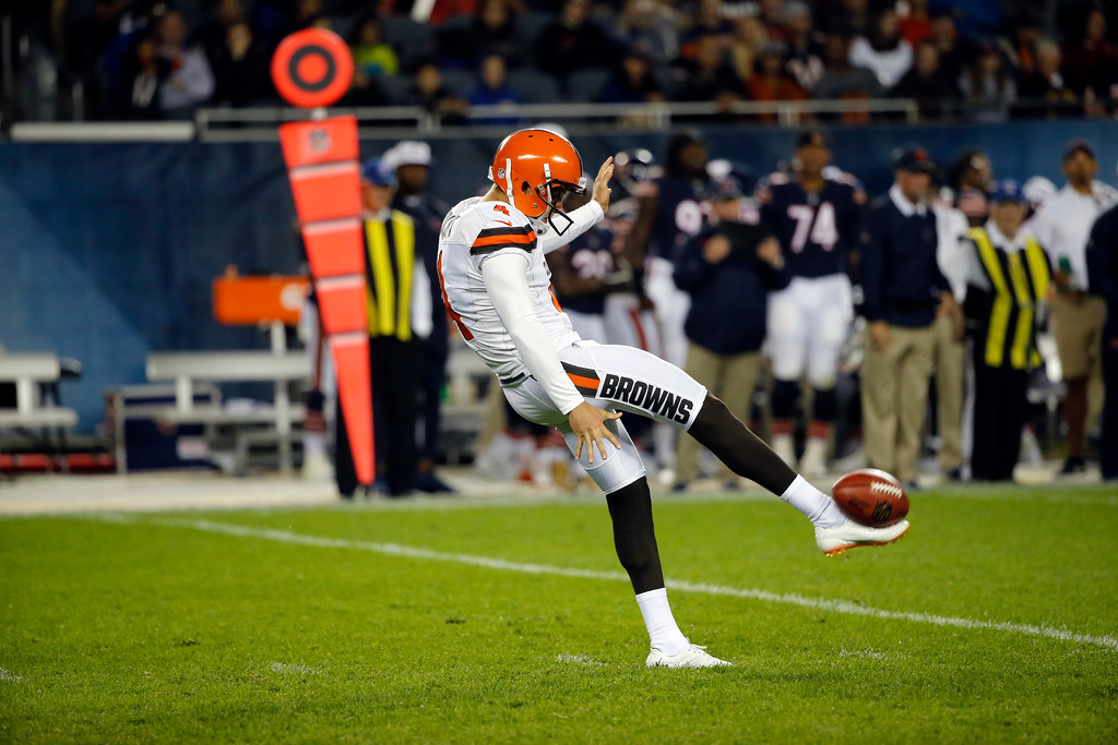 . Cleveland Browns punter Britton Colquitt (4) punts during the second half of an NFL preseason football game against the Chicago Bears, Thursday, Aug. 31, 2017, in Chicago. (AP Photo/Charles Rex Arbogast)