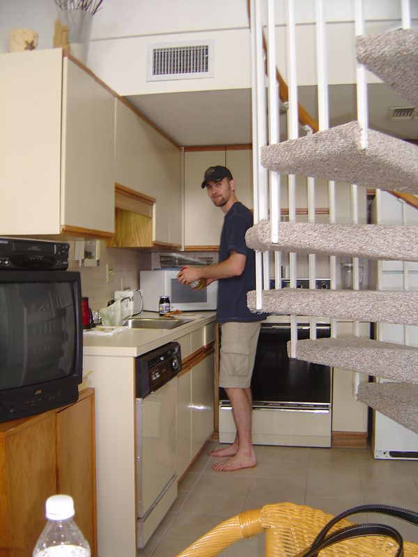Miles prepares a gourmet snack of PB&J in the kitchenette.