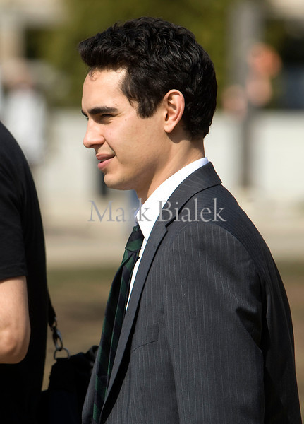 """Actor Max Minghella walks toward the movie set of """"The Ides of March"""" in downtown Ann Arbor, Michigan on March 17, 2011.  Clooney is directing and also starring in the movie.  (Photo by Mark Bialek)"""