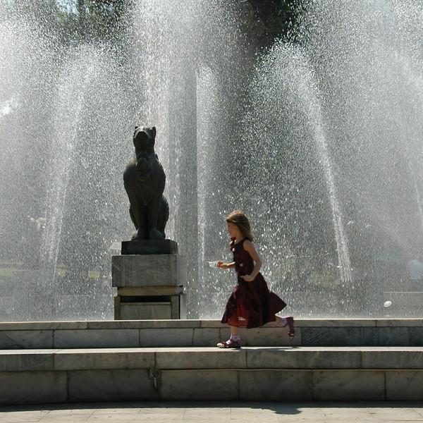 Girl Running at Fountain - Almaty, Kazakhstan