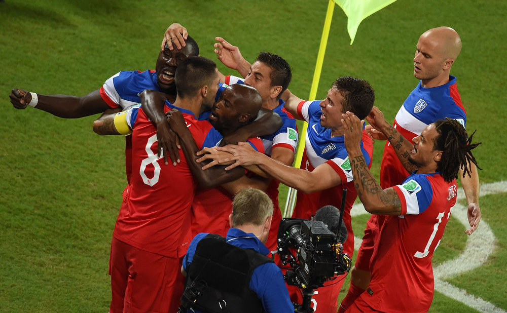 . US forward Clint Dempsey (L) celebrates with teammates after scoring during a Group G football match between Ghana and US at the Dunas Arena in Natal during the 2014 FIFA World Cup on June 16, 2014.   JAVIER SORIANO/AFP/Getty Images
