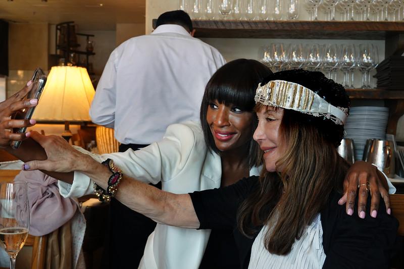 (L-R) ?, taking selfie with Sheila Ash