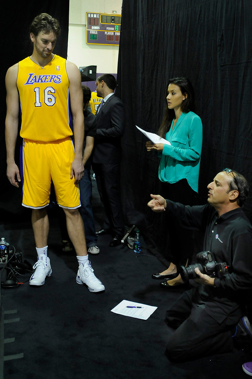 . Pau Gasol waits to have his photograph taken by team photographer Andy Bernstein. The Los Angeles Lakers held a media day at their El Segundo practice facility. Players were photographed for team materials, and interviewed by the press. El Segundo, CA. 9/27/2013. photo by (John McCoy/Los An8eles Daily News)