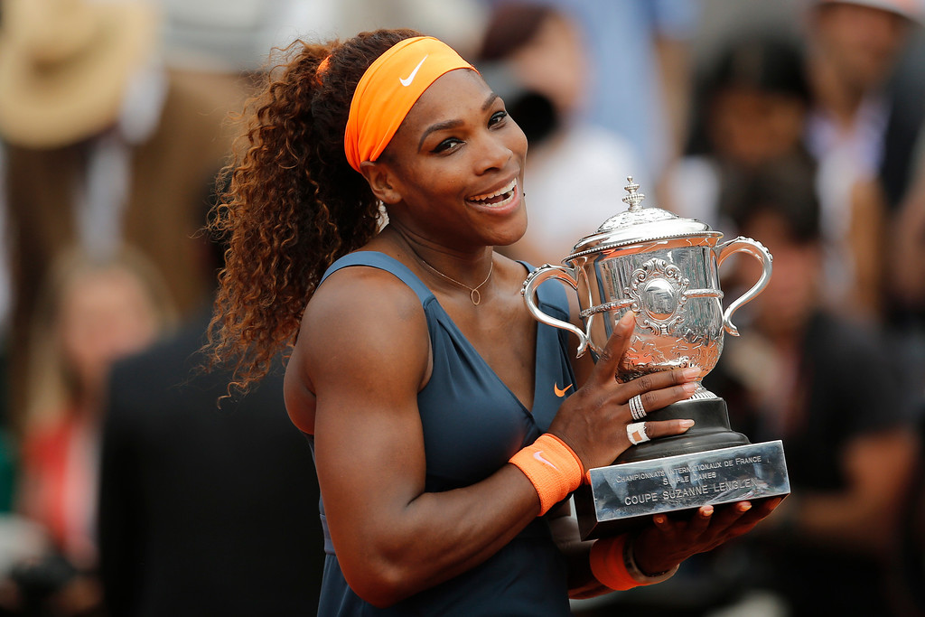 . Serena Williams of the U.S. holds the trophy after defeating Russia\'s Maria Sharapova in two sets 6-4, 6-4, in the women\'s final of the French Open tennis tournament, at Roland Garros stadium in Paris, Saturday June 8, 2013. (AP Photo/Christophe Ena)