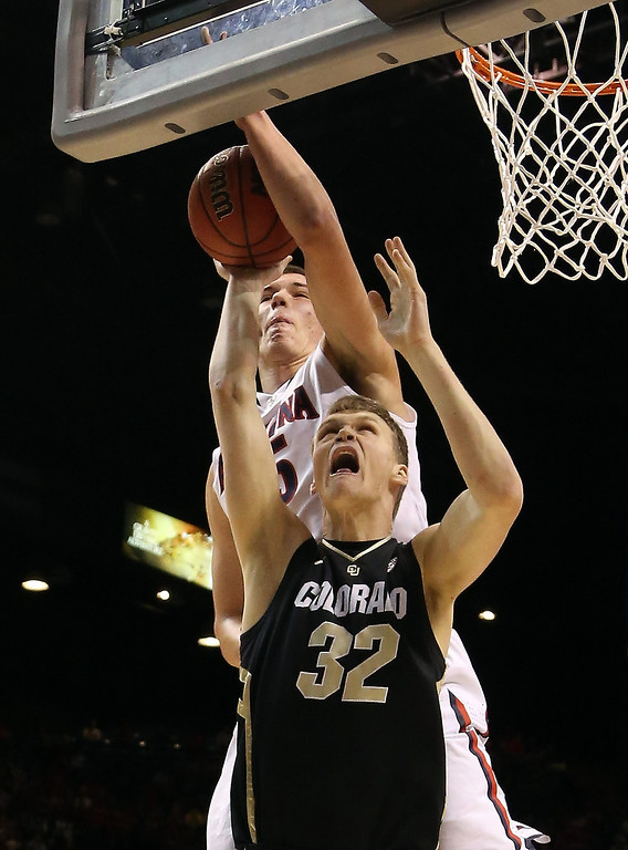 . Ben Mills #32 of the Colorado Buffaloes goes up for a shot in front of Kaleb Tarczewski #35 of the Arizona Wildcats in the first half during the quarterfinals of the Pac-12 tournament at the MGM Grand Garden Arena on March 14, 2013 in Las Vegas, Nevada.  (Photo by Jeff Gross/Getty Images)