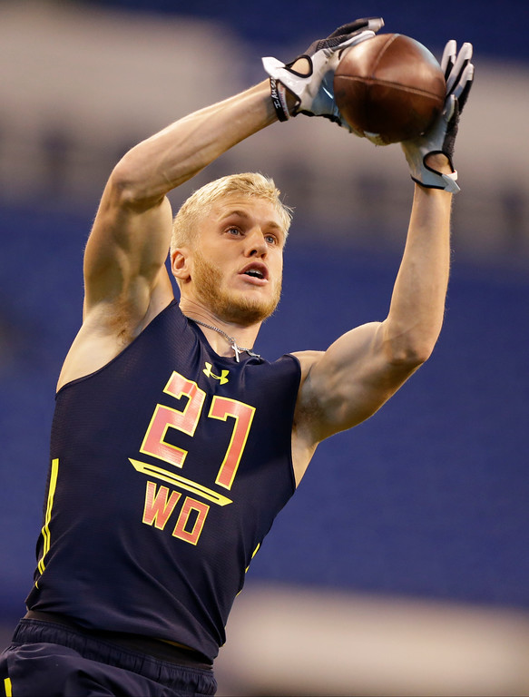 . Eastern Washington wide receiver Cooper Kupp runs a drill at the NFL football scouting combine in Indianapolis, Saturday, March 4, 2017. (AP Photo/Michael Conroy)