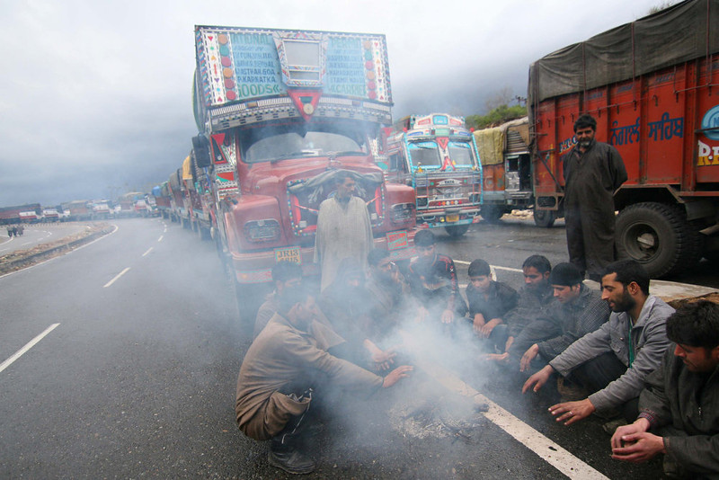 . A line of stranded vehicles are pictured as truck drivers warm themselves by a fire while they wait for the reopening of the Jammu-Srinagar national highway in the outskirts of Jammu on February 5, 2013. Kashmir remained cut off from the rest of the country as heavy snowfall in the Pir Panjal mountain range closed the Srinagar-Jammu highway and delayed all scheduled flights to the valley, authorities said. The highway is the only road connection between the landlocked valley and the rest of the country. AFP PHOTOSTRDEL/AFP/Getty Images