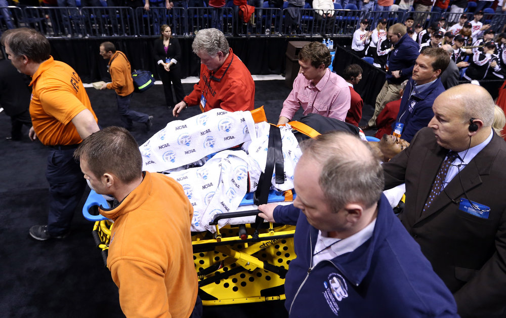 . Kevin Ware #5 of the Louisville Cardinals is taken off the court  on a backboard after he injured his leg in the first half against the Duke Blue Devils during the Midwest Regional Final round of the 2013 NCAA Men\'s Basketball Tournament at Lucas Oil Stadium on March 31, 2013 in Indianapolis, Indiana.  (Photo by Streeter Lecka/Getty Images)