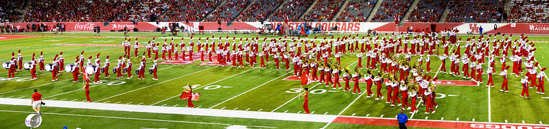 The band takes the field in the shape of a rocket ship.