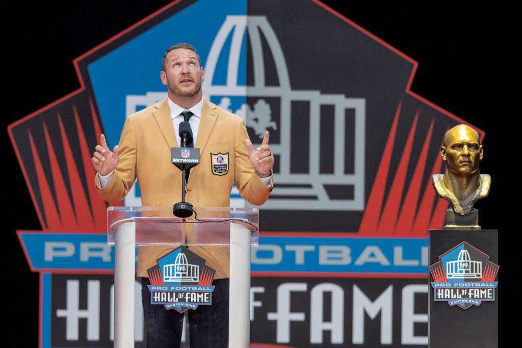 . Former Chicago Bears linebacker Brian Urlacher delivers his induction speech at the Pro Football Hall of Fame on Saturday, Aug. 4, 2018, in Canton, Ohio. (AP Photo/David Richard)