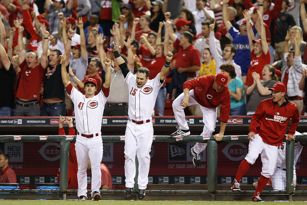 . CINCINNATI, OH - MAY 9: Cincinnati Reds players come out of the dugout to celebrate after Joey Votto\'s game-winning home run in the bottom of the ninth inning of the game against the Colorado Rockies at Great American Ball Park on May 9, 2014 in Cincinnati, Ohio. The Reds won 4-3. (Photo by Joe Robbins/Getty Images)