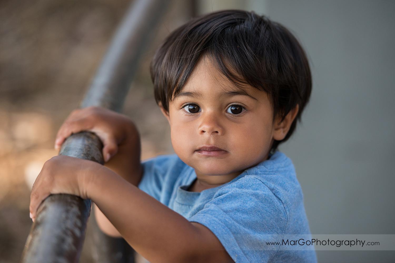 close-up portrait of little boy in blue shirt at Richmond Keller Beach