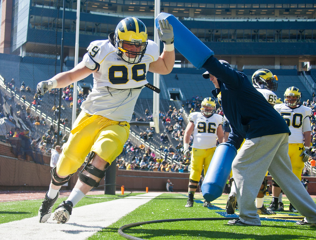 . Michigan defensive tackle Matthew Godin (99) runs around a blocking drill during the football team\'s annual spring game, Saturday, April 5, 2014, in Ann Arbor, Mich. (AP Photo/Tony Ding)