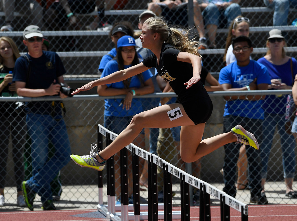 . Sarah Yocum, Faith Christian, launches over a hurdle on her way to victory in the girls 3A 300 meter final at the Colorado Track and Field State Championships at Jeffco Stadium May 21, 2016. Yocum won with a time of 44.15 (Photo by Andy Cross/The Denver Post)