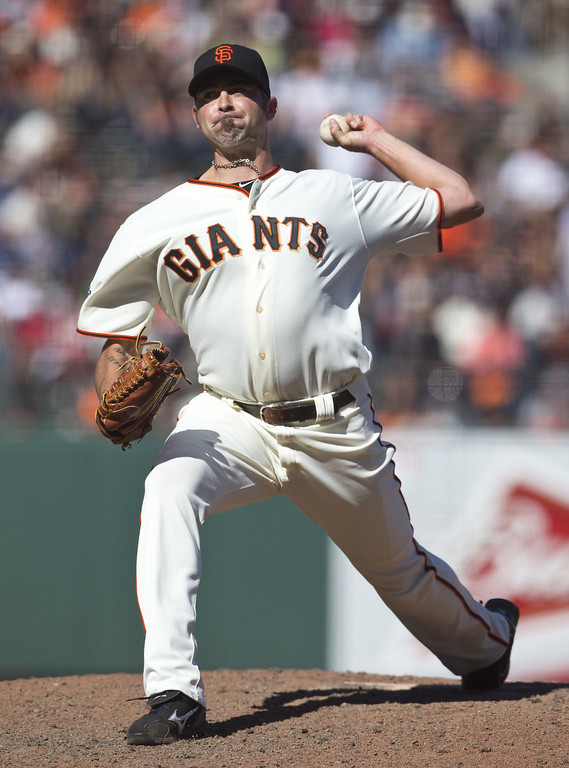 . Jeremy Affeldt #41 of the San Francisco Giants pitches against the Colorado Rockies during the ninth inning at AT&T Park on May 26, 2013 in San Francisco, California. The San Francisco Giants defeated the Colorado Rockies 7-3. (Photo by Jason O. Watson/Getty Images)