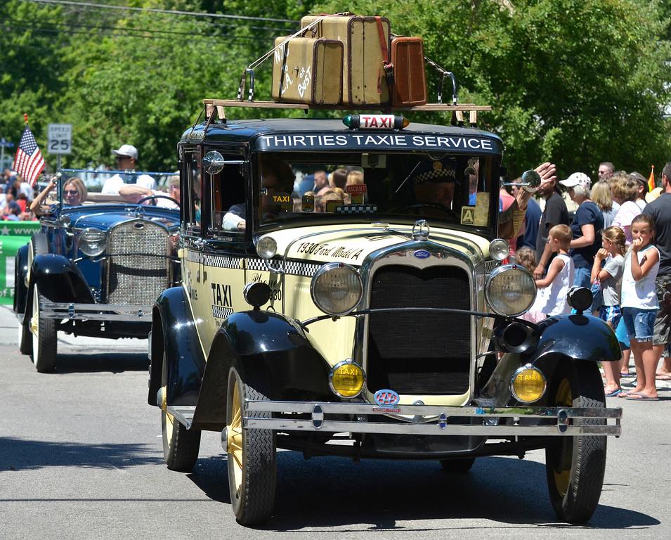 . Jeff Forman/JForman@News-Herald.com Classic cars in the Mentor Headlands July 4th Parade.