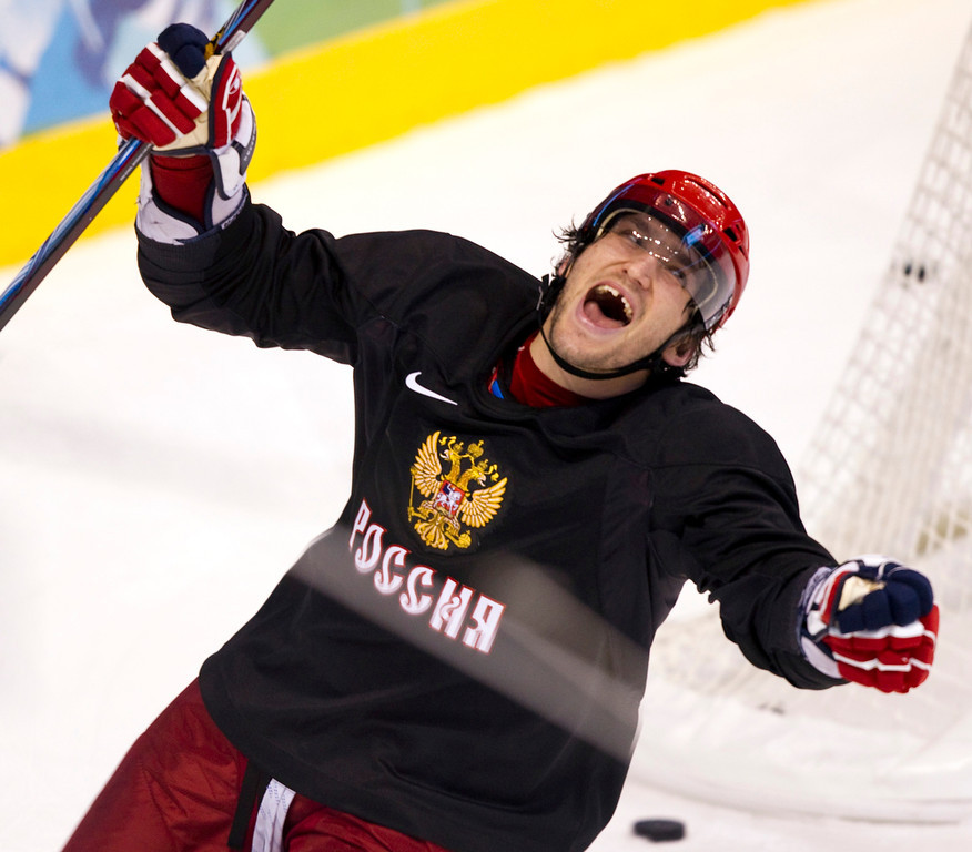 . Alex Ovechkin playfully celebrates a goal during the Russian Olympic men\'s ice  hockey team practice at Canada Hockey Place during the 2010 Vancouver Olympic Winter Games in Vancouver, British Columbia, Monday, Feb. 15, 2010. (AP Photo/The Canadian Press, Ryan Remiorz)