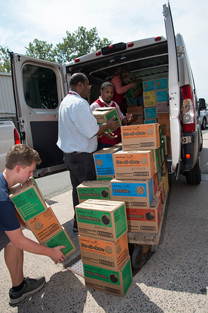 08/14/19 Wesley Bunnell | Staff Volunteers load a portion of over three thousand boxes of Girl Scout cookies at the Newington VA on August 14, 2019. The cookies were donated from the Girl Scouts and delivered by veterans and congressional candidates John Cain, Justin Anderson, and senate candidate Robert F Hyde.