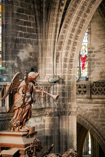 Wooden angel on the top of the organ, Santa Maria de la Sede Cathedral, Seville, Spain