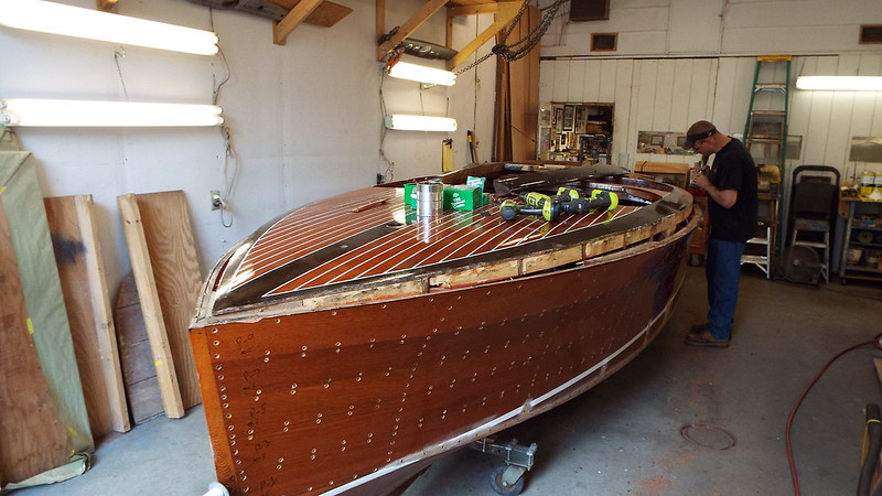 Another view of the port cover board being removed.