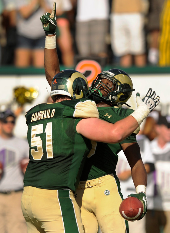 . FORT COLLINS, CO. - SEPTEMBER 14: Rams\' lineman Ty Sambrailo (51) helped tight end Kivon Cartwright (86) celebrate his touchdown in the second half. The Colorado State University football team defeated Cal Poly at Hughes Stadium in Fort Collins Saturday afternoon, September 14, 2013.  It was the Rams\' first home game and first win of the season. Photo By Karl Gehring/The Denver Post