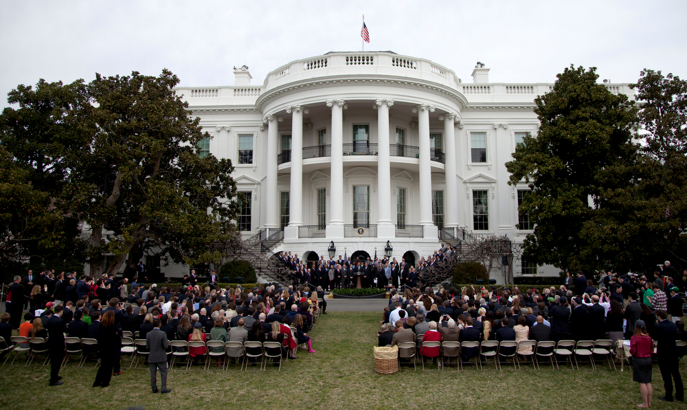 . President Barack Obama speaks on the South Lawn of the White House in Washington, Tuesday, April 1, 2014, during a ceremony honoring the 2013 World Series baseball champion Boston Red Sox. (AP Photo/Carolyn Kaster)