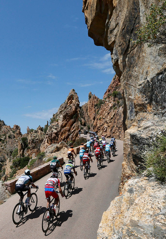 . The pack of riders cycles on its way past the calanque de Piana during the 145,5 km third stage of the centenary Tour de France cycling race from Ajaccio to Calvi, on the French Mediterranean island of Corsica July 1, 2013.  REUTERS/Jean-Paul Pelissier