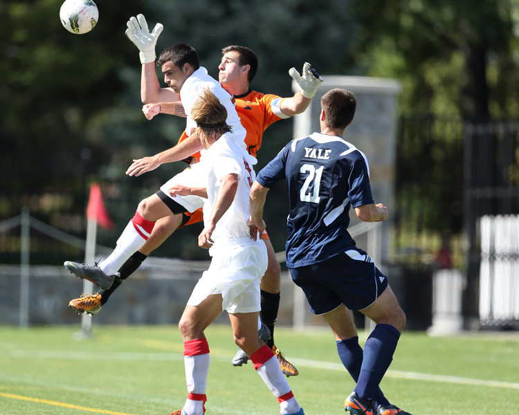 POUGHKEEPSIE, NY - SEPTEMBER 23: Yale Bulldogs goalie Bobby Thalman #1deflects shot in traffic during Yale verses Marist Soccer on September 23, 2012 at Tenney Stadium in Poughkeepsie New York.  Yale defeats Marist 2-1. (Photo by Sandy Tambone)