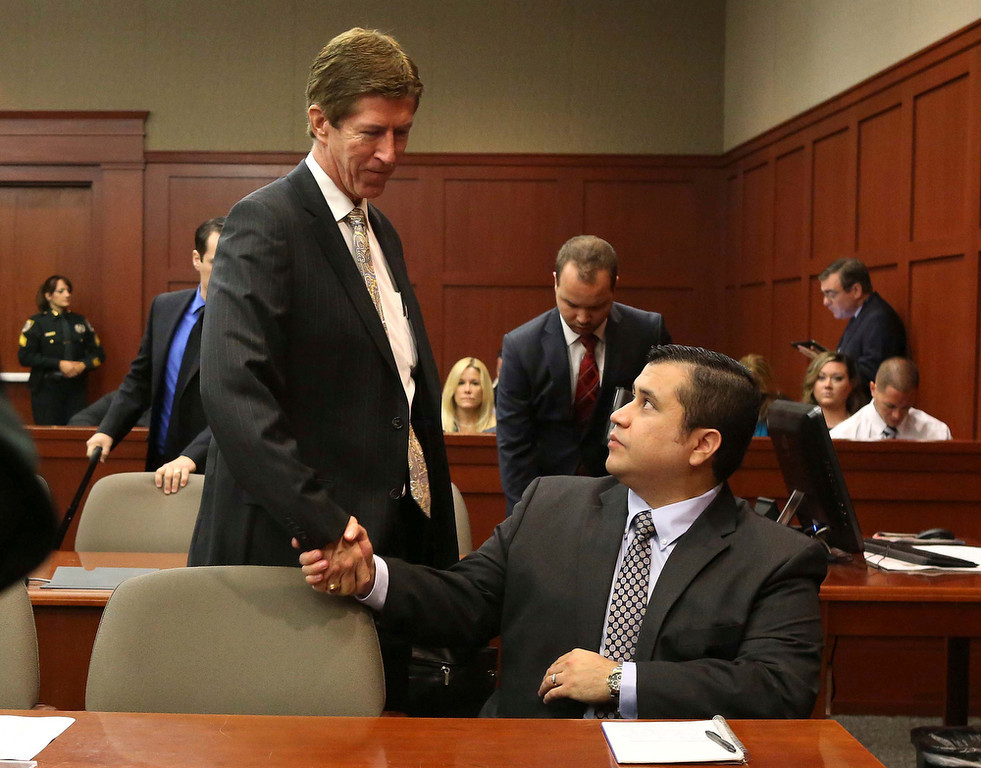 . George Zimmerman is greeted by defense attorney Mark O\'Mara (L) on the opening day of his trial in Seminole circuit court in Sanford, Florida, June 24, 2013. Zimmerman is accused in the fatal shooting of Trayvon Martin.     REUTERS/Joe Burbank/Pool