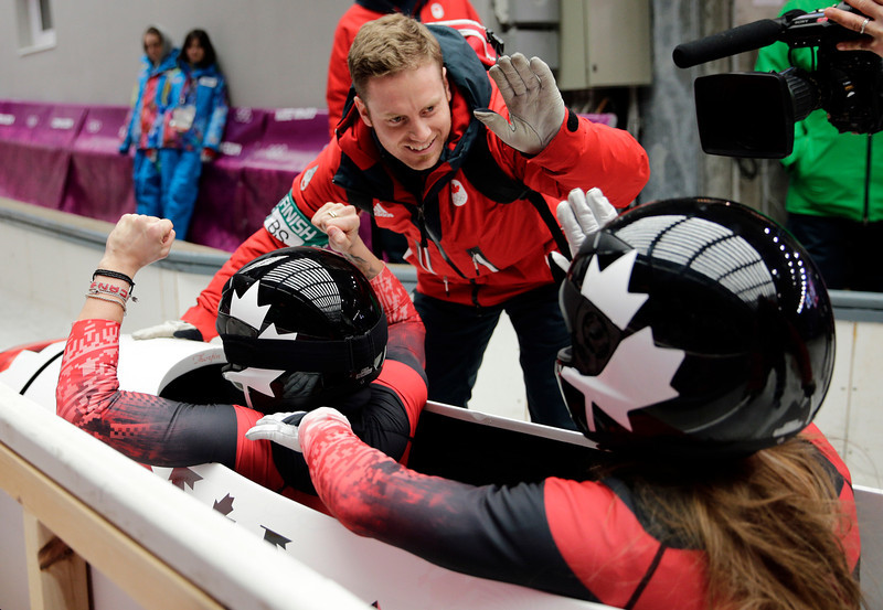 . The team from Canada CAN-1, piloted Kaillie Humphries with brakeman Heather Moyse, cross into the finish area to win the gold medal in the women\'s bobsled competition at the 2014 Winter Olympics, Wednesday, Feb. 19, 2014, in Krasnaya Polyana, Russia. (AP Photo/Jae C. Hong)