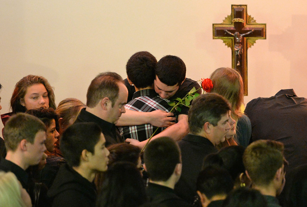 . Funeral services were held for Torrance High student Valentina d\'Alessandro Wednesday, December 11, 2013, in Torrance, CA. People visit the casket and give Valentina\'s brother Luca, center, hugs and flowers. D\'Alessandro was killed in a traffic collision in Wilmington Saturday. Photo by Steve McCrank/DailyBreeze