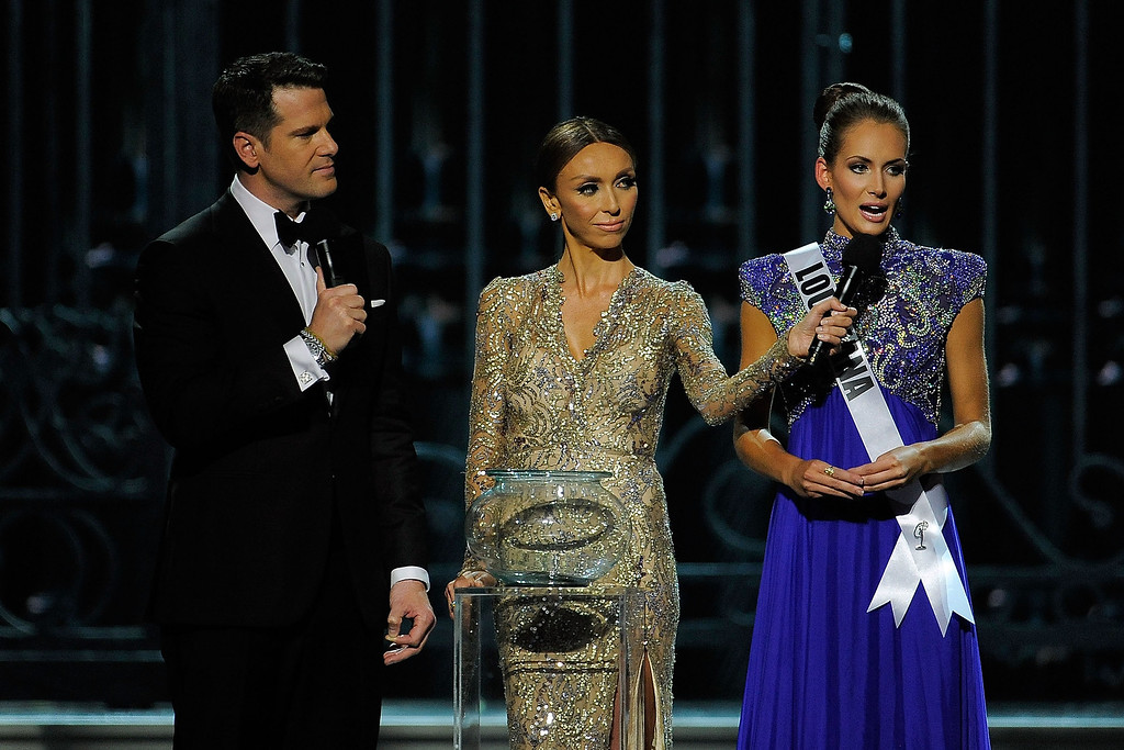 . Hosts Thomas Roberts (L) and Giuliana Rancic (center) speak with Miss Louisiana USA Brittany Alyson Guidry (R) during the 2014 Miss USA Competition at The Baton Rouge River Center on June 8, 2014 in Baton Rouge, Louisiana.  (Photo by Stacy Revere/Getty Images)