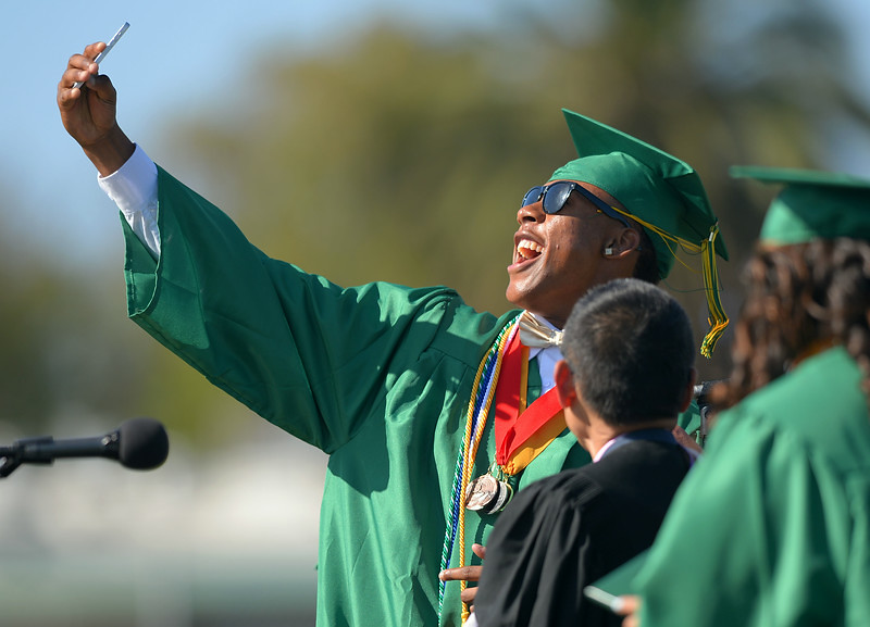 ". ""In a recurring moment, graduates in Narbonne High\'s class of 2014 take selfies with Principal Gerald Kobata as they receive their diplomas in Harbor City, CA on Wednesday, June 4, 2014. (Photo by Scott Varley, Daily Breeze) \"""