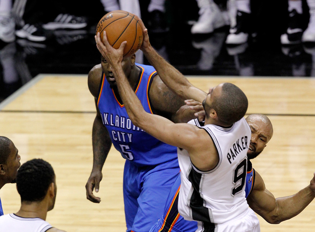 . Tony Parker #9 of the San Antonio Spurs goes up for a shot as he is hit by Derek Fisher #6 of the Oklahoma City Thunder in the first half in Game One of the Western Conference Finals during the 2014 NBA Playoffs at AT&T Center on May 19, 2014 in San Antonio, Texas.  (Photo by Chris Covatta/Getty Images)