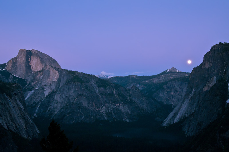 A Full Moon Lights up the night sky and creats pretty purple colors above Half Dome