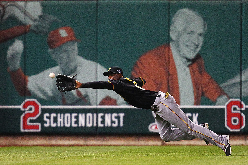 . Starling Marte #6 of the Pittsburgh Pirates makes a diving catch for a third inning out against the St. Louis Cardinals during Game Five of the National League Division Series at Busch Stadium on October 9, 2013 in St Louis, Missouri.  (Photo by Dilip Vishwanat/Getty Images)
