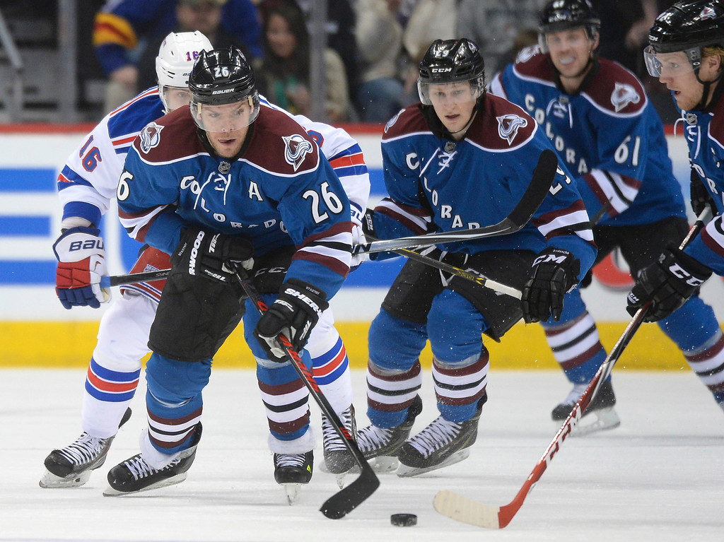 . Gabriel Landeskog, right, fed the puck to line mate Paul Stastny, left, in the first period as the Colorado Avalanche hosted the New York Rangers Thursday night, April 3, 2014 at the Pepsi Center in Denver. (Photo by Karl Gehring/The Denver Post)