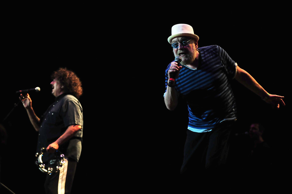 """. Guitarist Mark Volman, left, and vocalist Howard Kaylan of \""""The Turtles\"""" perform their 1966 hit \""""You Baby\""""  at the Happy Together concert at the State Fair Grandstand on Monday evening, August 26, 2013.   (Pioneer Press: Scott Takushi)"""