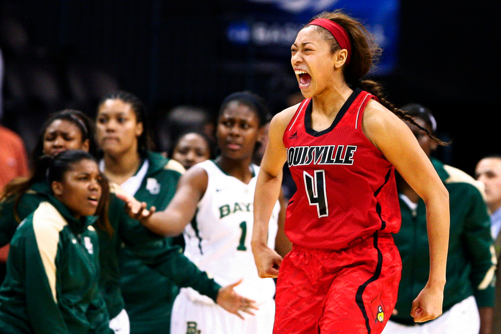 . Louisville guard Antonita Slaughter (4) reacts to a play against Baylor during the second half of a regional semifinal game in the women\'s NCAA college basketball tournament in Oklahoma City, Sunday, March 31, 2013.  Louisville won 82-81.  (AP Photo/Alonzo Adams)