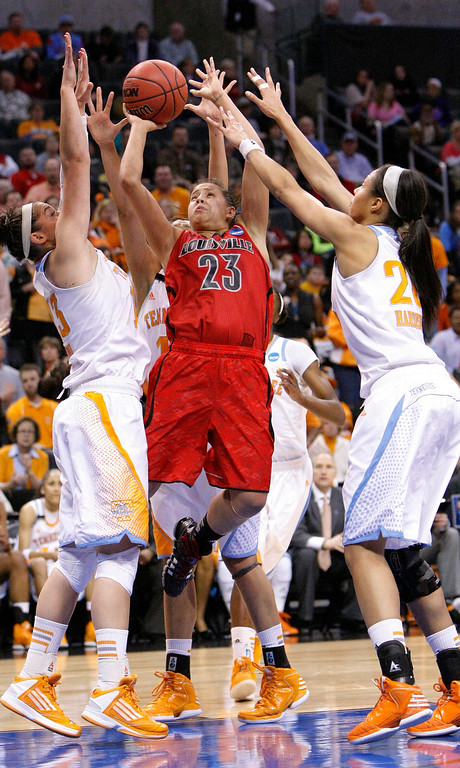 . Louisville guard Shoni Schimmel, center, shoots between Tennessee\'s Taber Spani, left, and Isabelle Harrison, right, during the first half of the Oklahoma City regional final in the NCAA women\'s college basketball tournament in Oklahoma City, Tuesday, April 2, 2013. (AP Photo/Alonzo Adams)