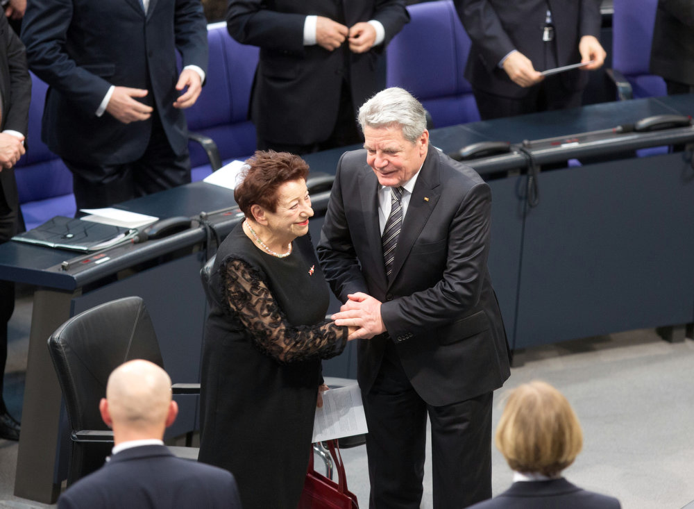 Description of . Holocaust survivor Inge Deutschkron and German President Joachim Gauck attend a commemorative event for the victims of the Nazi era at the German Bundestag parliament in Berlin, Germany, Jan. 30, 2013. Deutschkron, a 90-year-old Jewish Berliner and writer, recalled Germans celebrating Hitler's rise to power as she addressed lawmakers. She remembered her family growing more tense over the subsequent weeks amid worries about Hitler's paramilitary SA thugs who roamed the streets. (AP Photo/dpa, Kay Nietfeld)