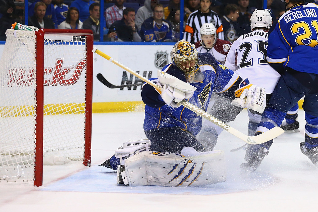 . ST. LOUIS, MO - NOVEMBER 14:  Jaroslav Halak #41 of the St. Louis Blues deflects a puck against the Colorado Avalanche at the Scottrade Center on November 14, 2013 in St. Louis, Missouri.  (Photo by Dilip Vishwanat/Getty Images)